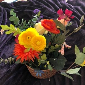 Artificial flowers in  basket done by seller